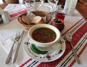 Traditional peasant's beef soup with sour cream and bread.