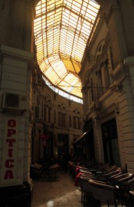 Inside Pasajul Macca-Vilacrosse (a fork-shaped, yellow glass covered arcaded street in central Bucharest).
