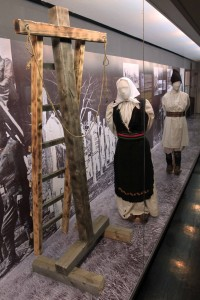 """Diorama of two Serbs ready to be """"hanged"""" (actually, the victims of this cruel execution device were suspended and then garotted from behind, which was much more painful and lasted longer than a traditional hanging)."""