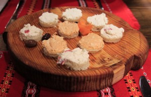 Platter of bits of bread covered with three types of Bulgarian cheese spreads.