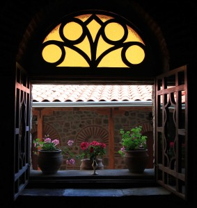 An open window with flowers at the monastery.