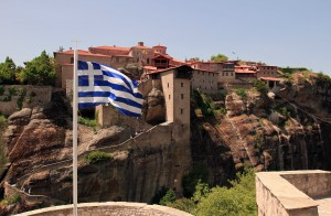 The Greek flag in front of the Great Meteoro Monastery.