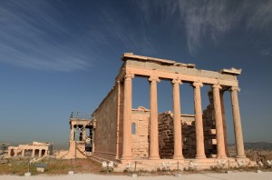 The Erechtheion, built in 406 BC, with the Propylaea in the background.