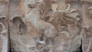 The central block of the western frieze of the Parthenon - a horseman trying to restrain his unruly horse by placing his right foot on a rock.