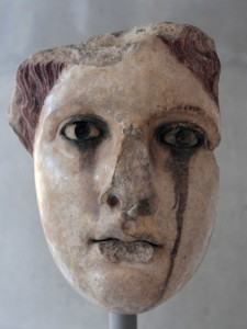 Head of a female statue from the 2nd-century AD (the color that has leaked below her eyes is the product of oxidation of the statue's bronze eyelashes).