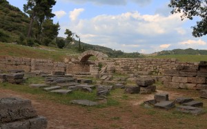 The ruins of the Echo Stoa next to the arched entrance to the Stadium.