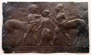 Bronze sheet from the Archaic Period, depicting two centaurs burying the leader of the Lapiths, Caeneus, in the ground with uprooted trees; meanwhile Caeneus stabs both centaurs with daggers, but he was not saved.