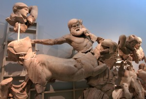 Scene from the west pediment from the Temple of Zeus, depicting a centaur who has assaulted a Lapith woman and is about to be dealt a blow by Theseus (on the left).