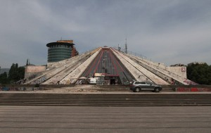 """The """"Pyramid of Tirana"""" - a modern pyramidal-shaped building that was opened in 1988 AD and originally served as a museum dedicated to the late communist leader Enver Hoxha and his legacy."""
