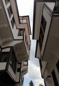 Looking up at two buildings that exhibit Ohrid traditional architecture (the one on the left is the House of the Robev family).