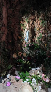The Grotto of Our Lady of Lourdes, on the right, inside the Church of St. Ignatius.
