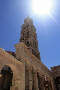 The sun shining down on the Bell Tower of the Cathedral of Saint Domnius.