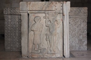 Medieval-style bas-relief on the baptistry inside the old Temple of Jupiter.