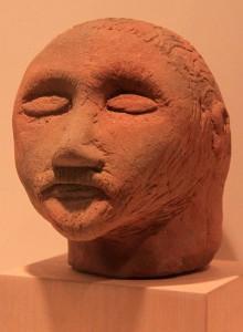A ceramic male head (Roman Era, 2nd- to 3rd-century AD).