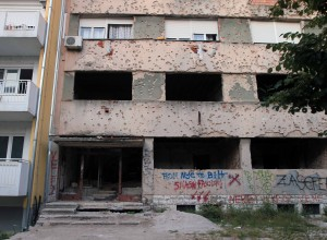Building that was situated on the dividing line between the Croatian and Bosnian armies, still bearing the scars from that war.