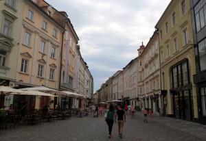 Pedestrians walking through Ljubljana.