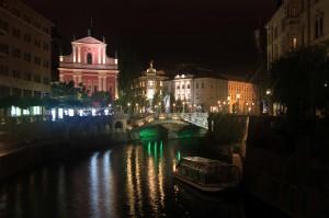 The Triple Bridge and the Ljubljanica River at night.