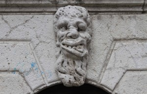 "A grotesque sculpture above a doorway, called a ""scacciadiavoli"" (or ""scare-demon""); it was used to keep bad spirits away."