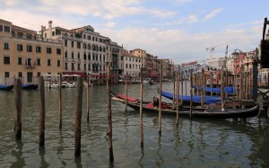 More gondolas and docking posts in the Grand Canal.