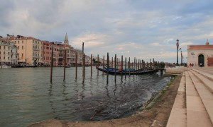 Docking poles and gondolas next to the Basilica di Santa Maria della Salute and the southern end of the Grand Canal.