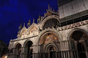 Closeup of St. Mark's Basilica at night.