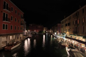 Yet another photograph of a canal at nighttime.