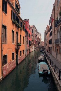 A canal with colorful buildings in Venice.