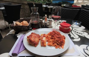 My meal of tagliatelle with meat sauce, lasagna, cannelloni, bread, and the house red wine.