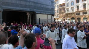 A procession leaving the Florence Baptistery and entering in to the Cathedral to celebrate mass on St. John the Baptist's Feast day.