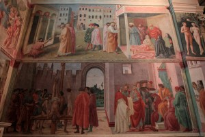The right wall of the Brancacci Chapel with 'The Healing of the Cripple; The Raising of Tabitha' (top) by Masaccio, and 'The Crucifixion of St. Peter; St. Peter and Simon Magus before Nero' (bottom) by Filippo Lippi.