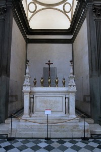 "The altar inside the Sagrestia Nuova (""New Sacristy""); the two candelabras were designed by Michelangelo."