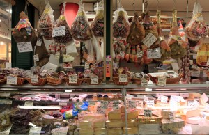 Various meats, cheeses, and olives on sale inside the Mercato Centrale.