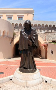 Statue of François Grimaldi outside the palace, commemorating his capture of the fortress disguised as a monk in 1297 AD.