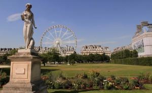 Statue and Ferris wheel in Tuileries Garden.
