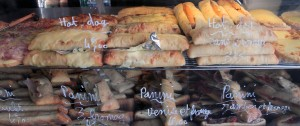 Hot dogs and panini for sale at a shop in Paris.