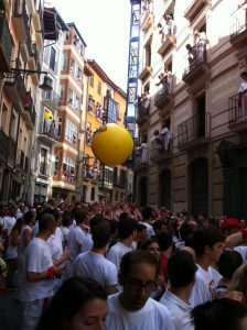 A giant ball being bounced around by partiers before the chupinazo (the opening of the San Fermin Festival) at noon.