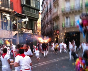 "The ""fire-bull"" running around the streets of Pamplona."