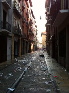 Trash strewn all over the street from last night's partying.