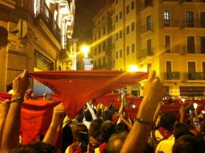 Partiers holding up their red kerchiefs during the closing ceremony for the San Fermin Festival (at midnight).
