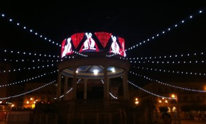 The gazebo in the center of the Plaza del Castillo, lit up with depictions of Saint Fermin.