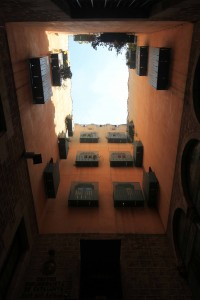 Looking up from a courtyard inside an apartment complex.