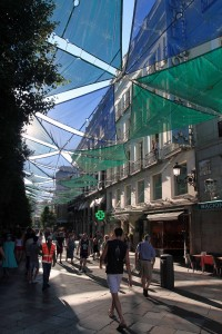 Shade sails over a street in Madrid.