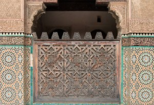 Decorative wooden screen and walls in Bou Inania Madrasa.