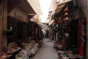 Shops flanking both sides of the street in Fes' medina.