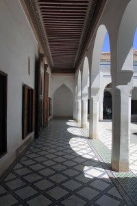 An arched colonnade surrounding a courtyard inside the palace.