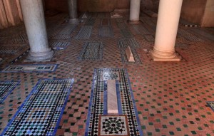 Rectangular markers on the floor indicating more burials at the Saadian Tombs.