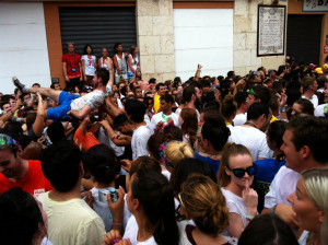 A man crowd-surfing before the 11:00 start of La Tomatina.