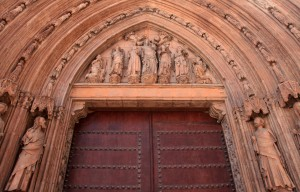The sculpted reliefs surrounding an entryway to the Valencia Cathedral.