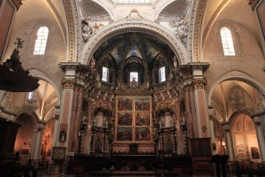The high altarpiece and frescoes inside Valencia Cathedral.