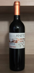 A bottle of Spanish red wine crafted from Moristel, Tempranillo, and Cabernet Sauvignon grapes.